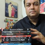 Joygopal Podder with 11 of his books