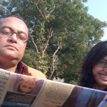 Piya and Joygopal P. reading the newspaper