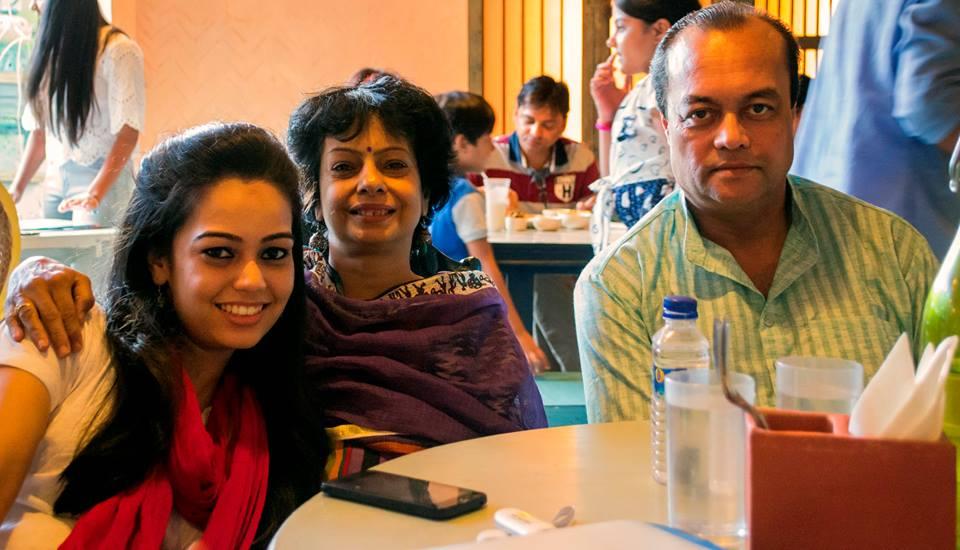 Photo of Panvi, Priti and Joygopal Podder at a restaurant